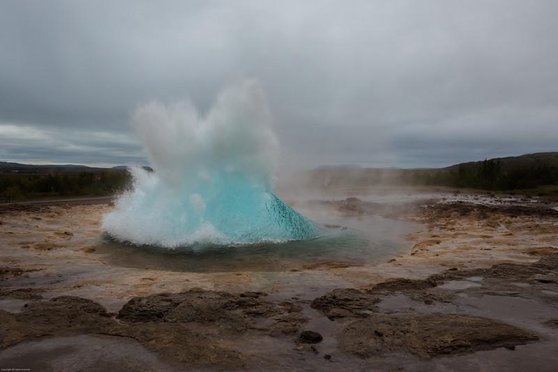 Strokkur geyser beginning to erupt