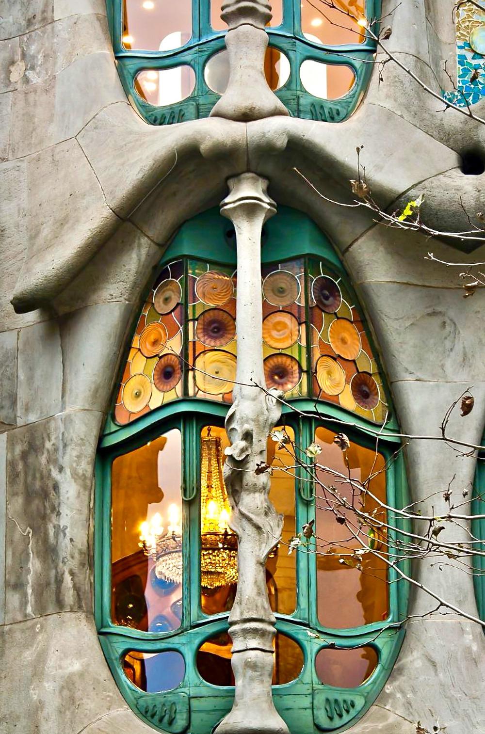 a skinny shin bone on a window of Casa Batlló