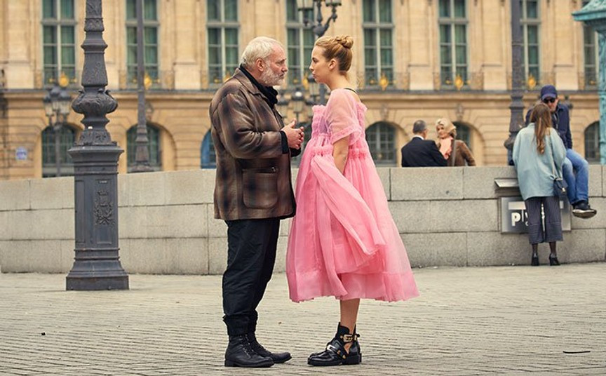 Villanelle in the Place Vendôme in Paris in a frothy pink Molly Goddard dress and Balenciga military boots.