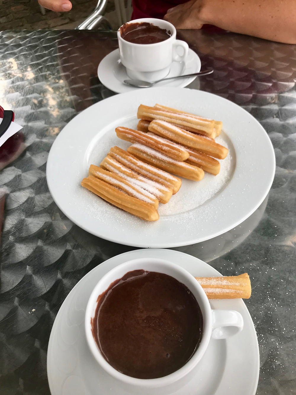 hot chocolate and churros at a cafe in Santillana del Mar