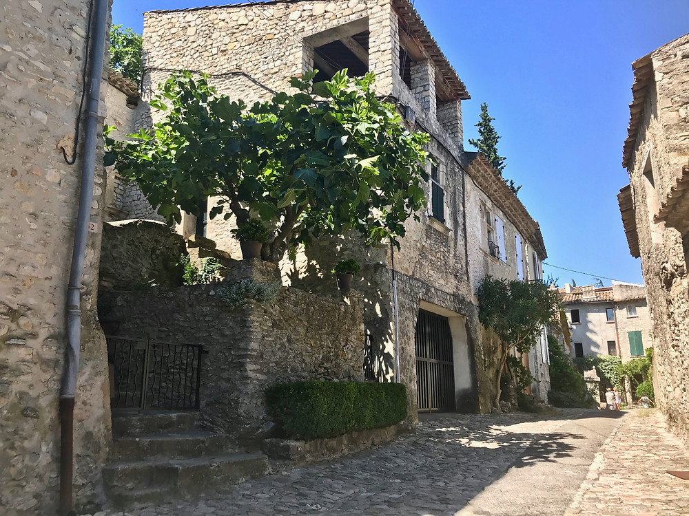 stone streets and homes in the medieval part of Vaison La Romaine