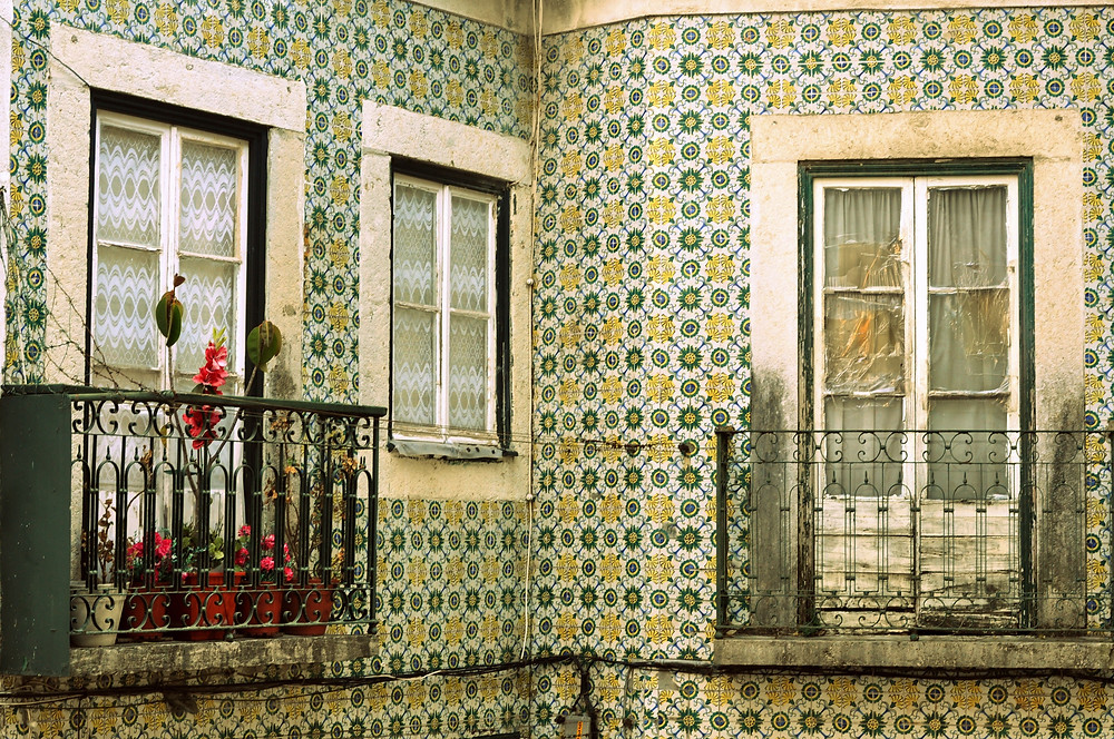 green, yellow, and white tiled home in Alfama