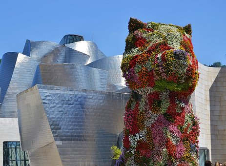 "Jeff Koon's monumental ""Puppy"" sculpture outside the Guggenheim Museum in Bilbao Spain"