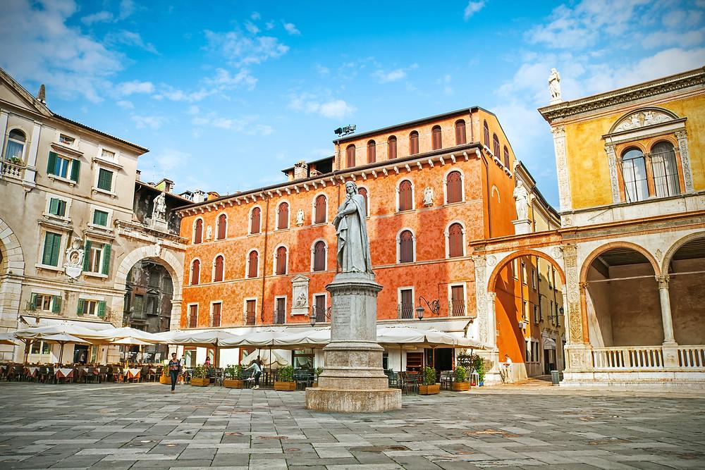 Piazza dei Signori with a statue of Dante