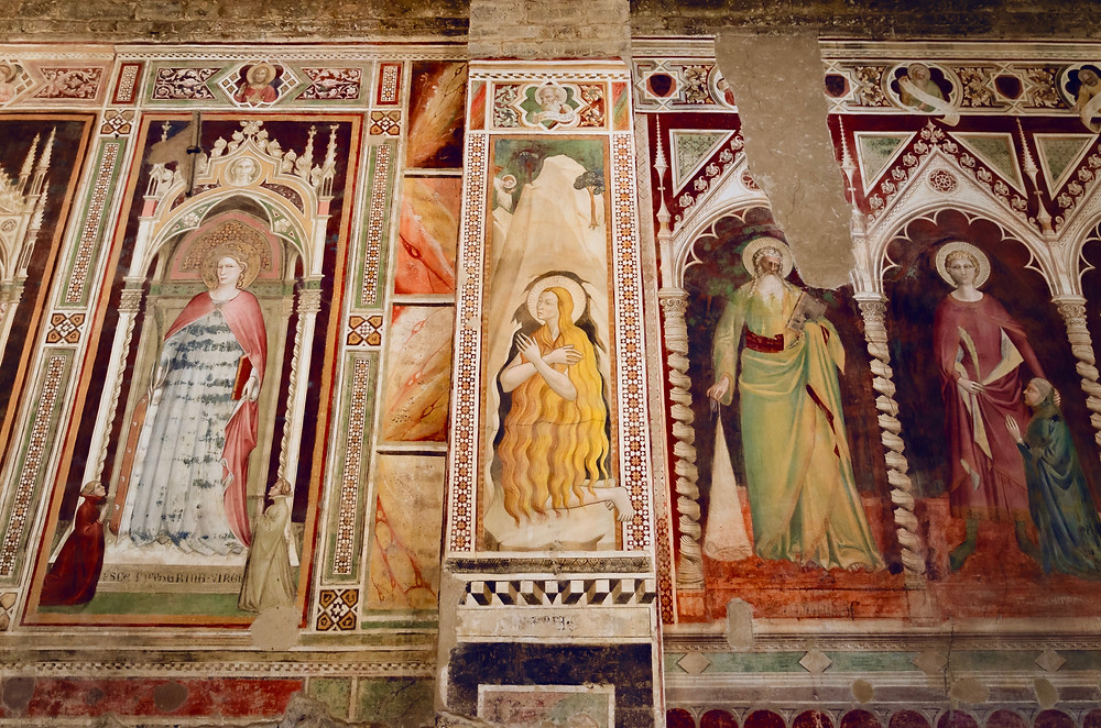 detail of the paintings and frescos from the gothic medieval period on the side walls of the naves