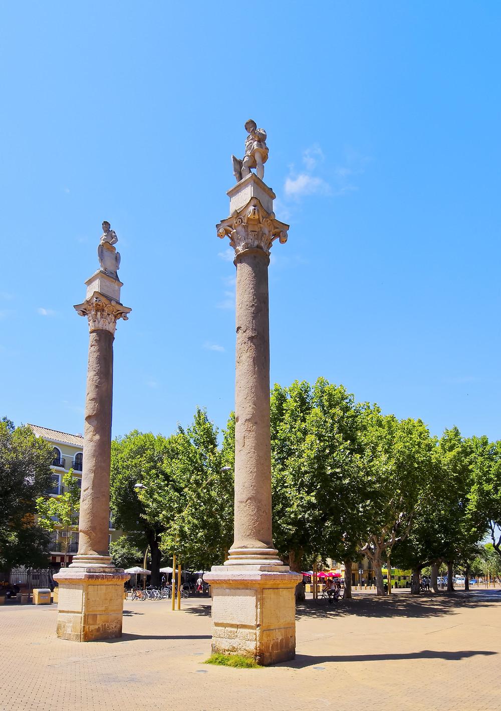 marble Roman columns in the Alameda de Hercules square