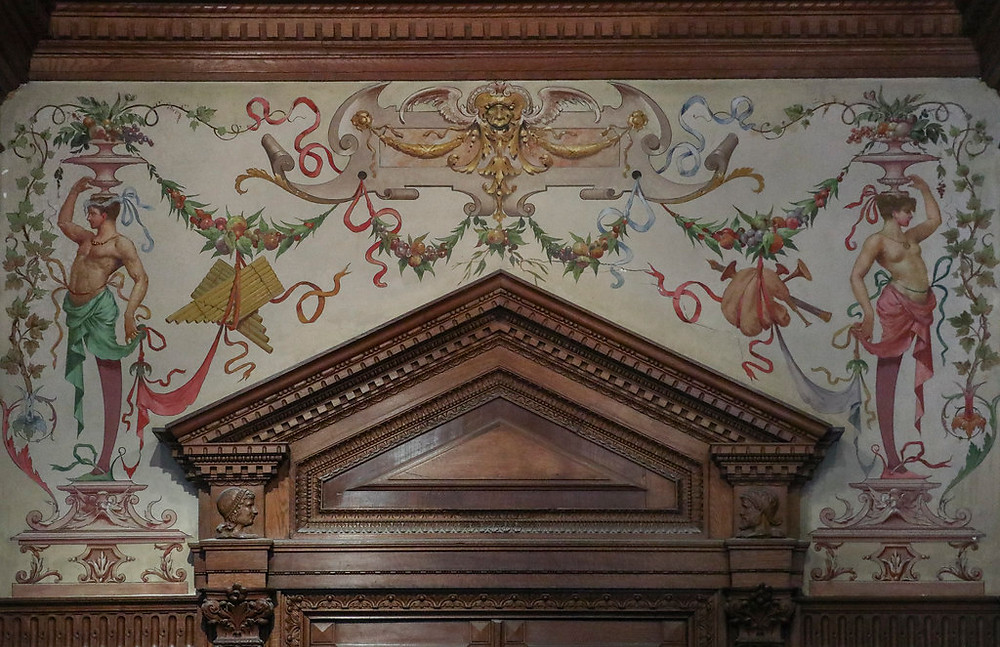 a carved mantle and painted wall in the palace of Quinta da Regaleira