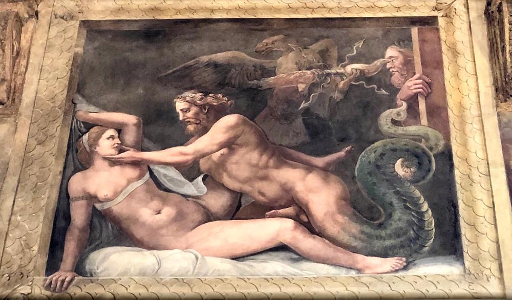 graphic scene of  a serpent-Zeus ravishing Olympia