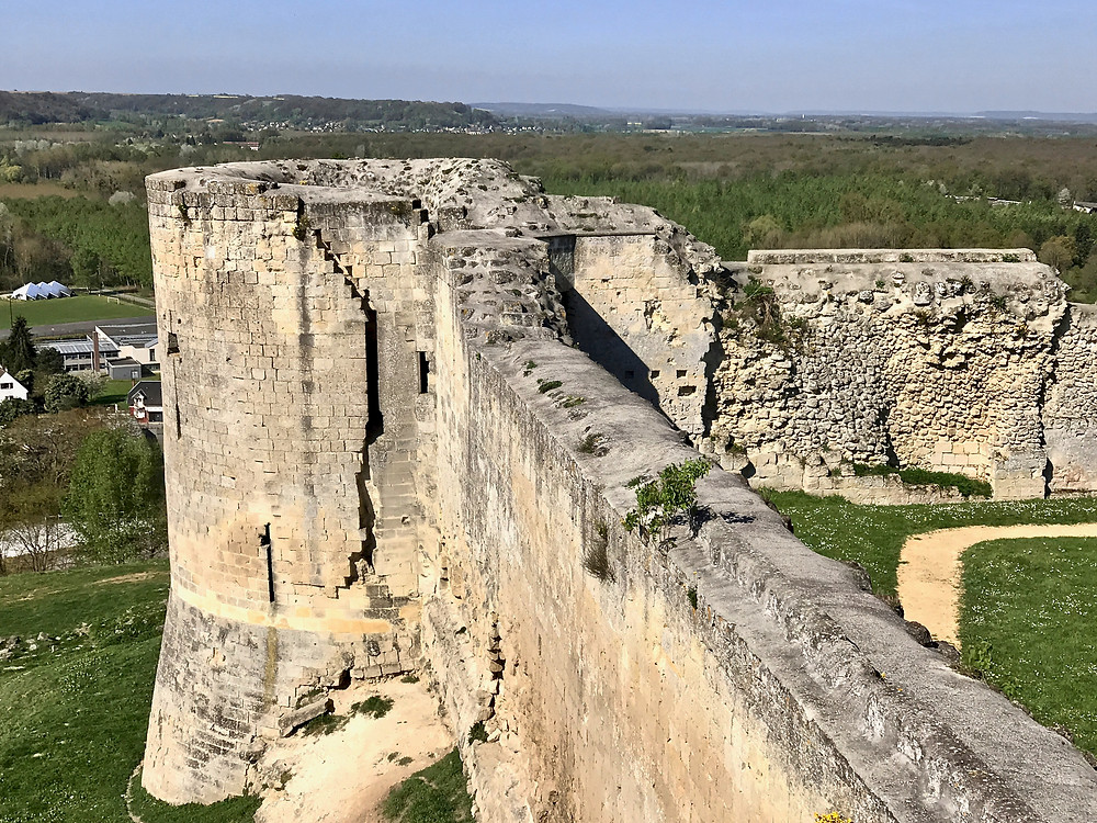 fortified walls of the Chateau de Coucy, an off the beaten path day trip from Paris steeped in history
