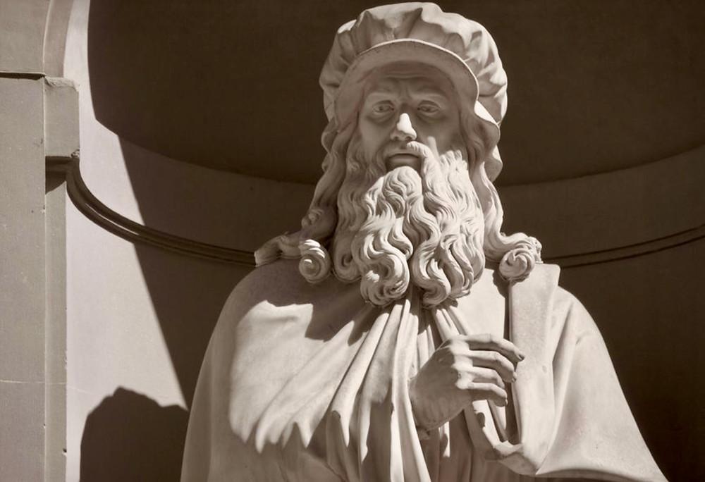 detail of statue of Leonardo in the Piaza della Scala in Milan