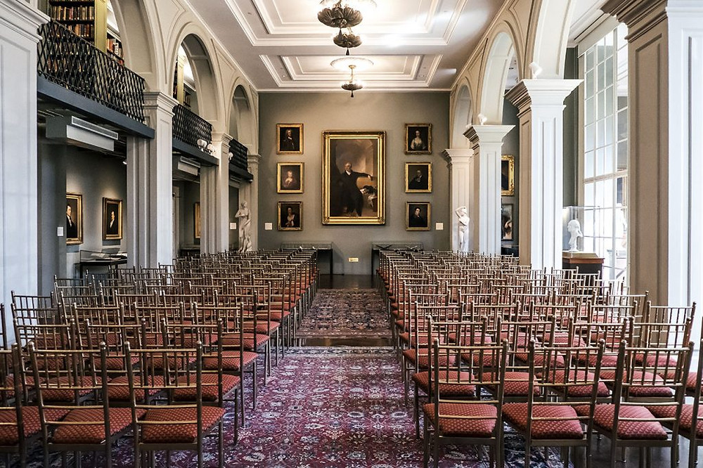 first floor reading room with portraits