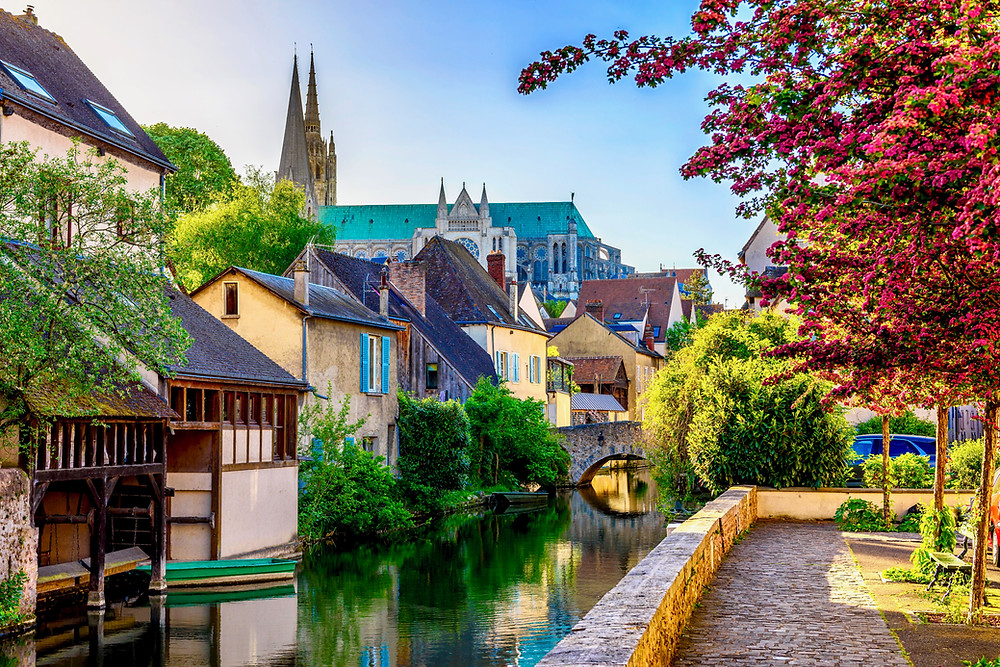 the town of Chartres, with its cathedral towering above