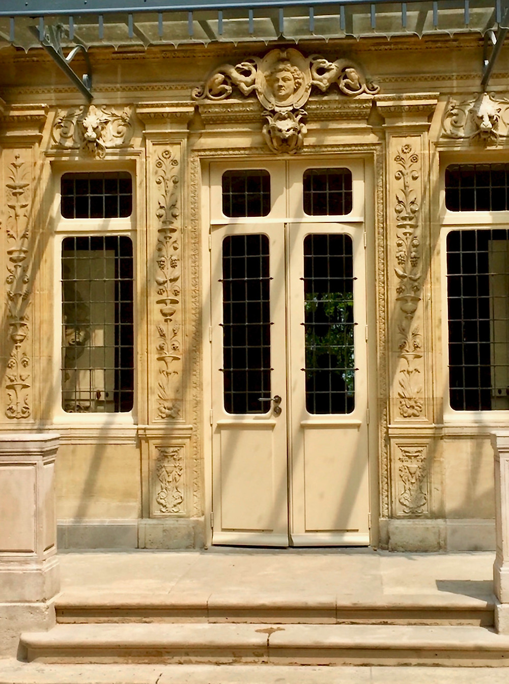 intricately carved details, including a bust of Dumas, on the Chateau de Monte Cristo