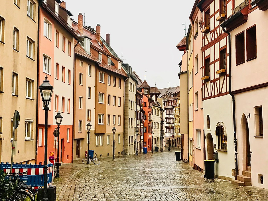 typical cute street with pastel colored houses in Bamberg