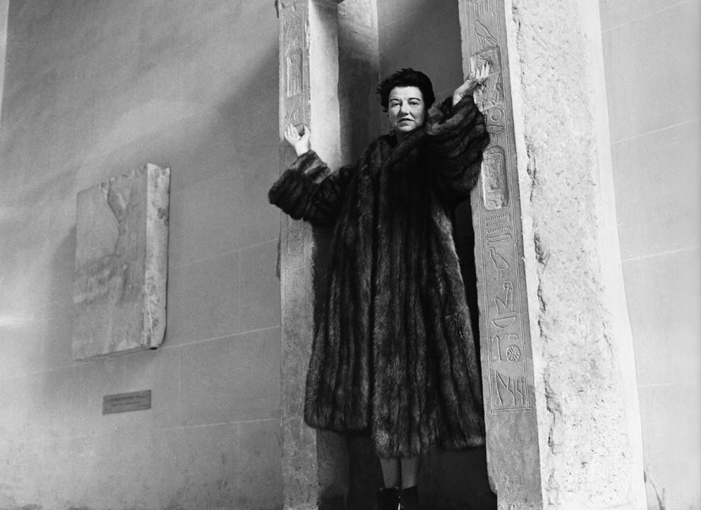 Peggy Guggenheim at her palazzo in a coat from her fur collection