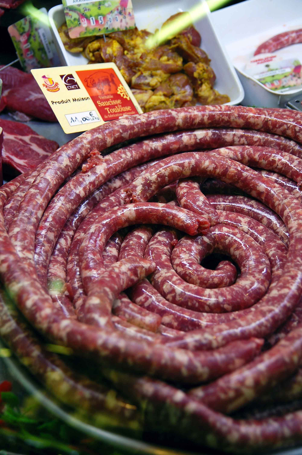 a spiral of the famed saucisse Toulouse at the Market Victor Hugo In Toulouse