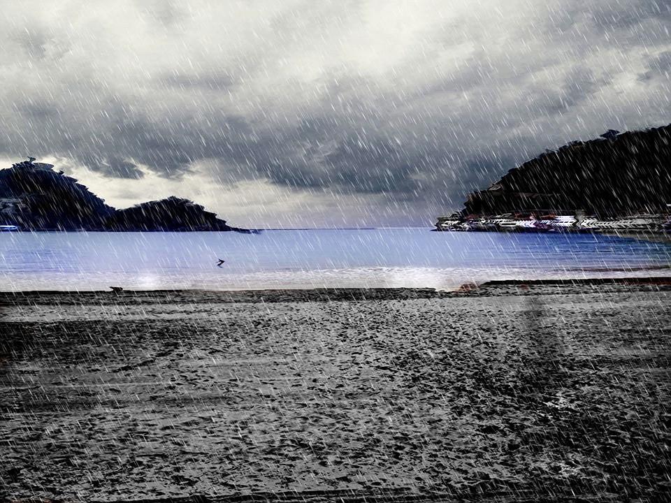 a rainy day at La Concha Beach in San Sebastian Spain