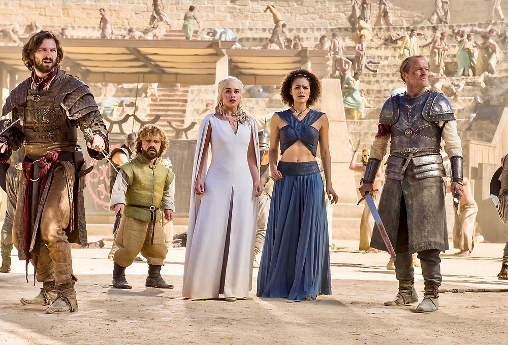 Daenerys and her protectors watch for the arrival of Drogon in the bullring in Osuna. image source: HBO