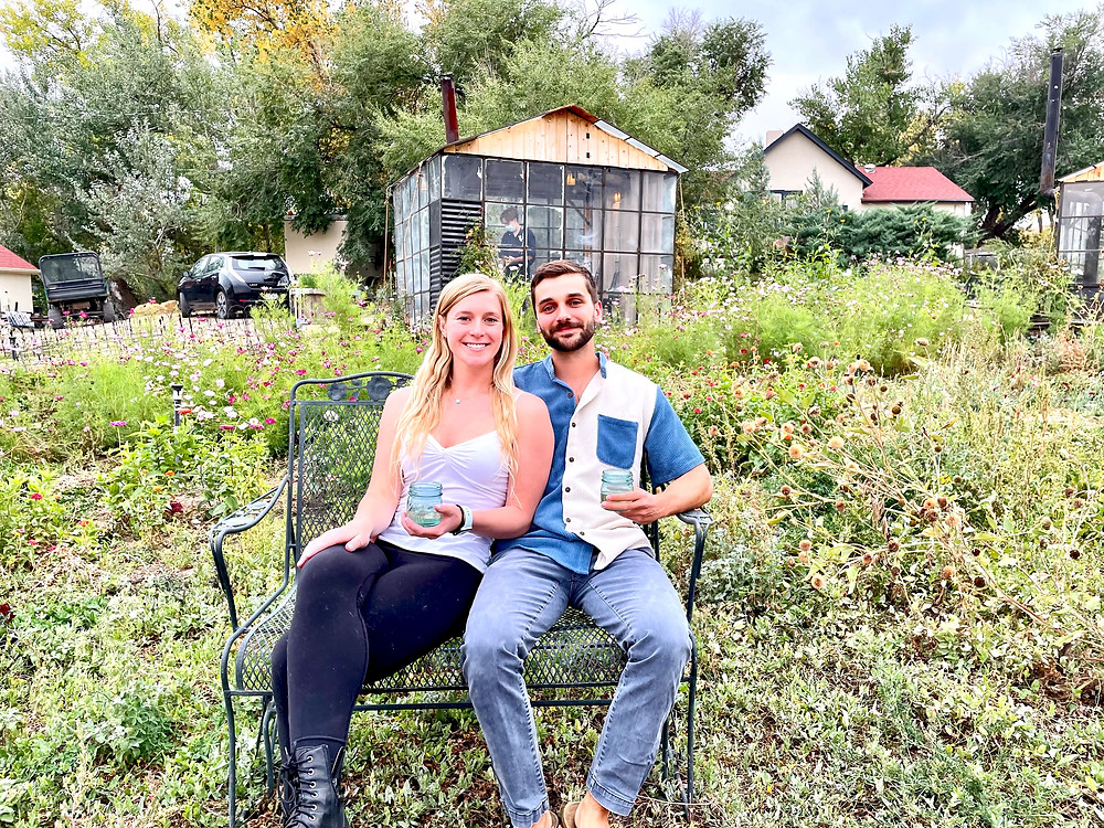 my daughter and her boyfriend amid the wildflowers at Black Cat Farms