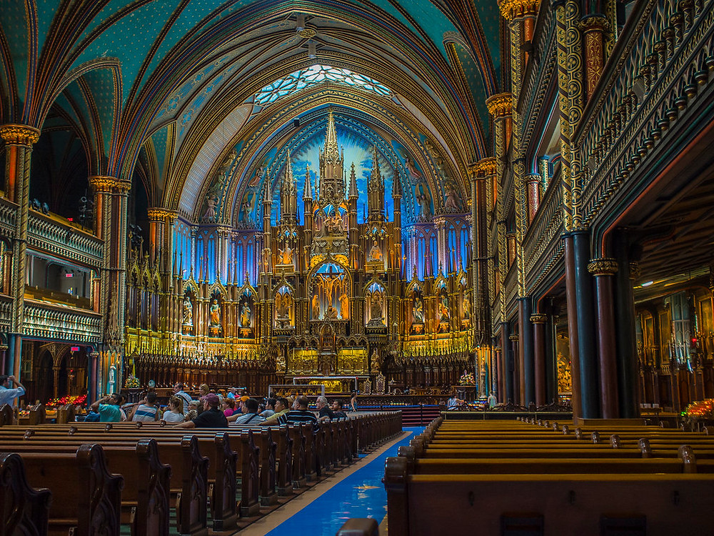 the blue-hued interior of Notre Dame Basilica in Montreal, an unmissable site in Montreal