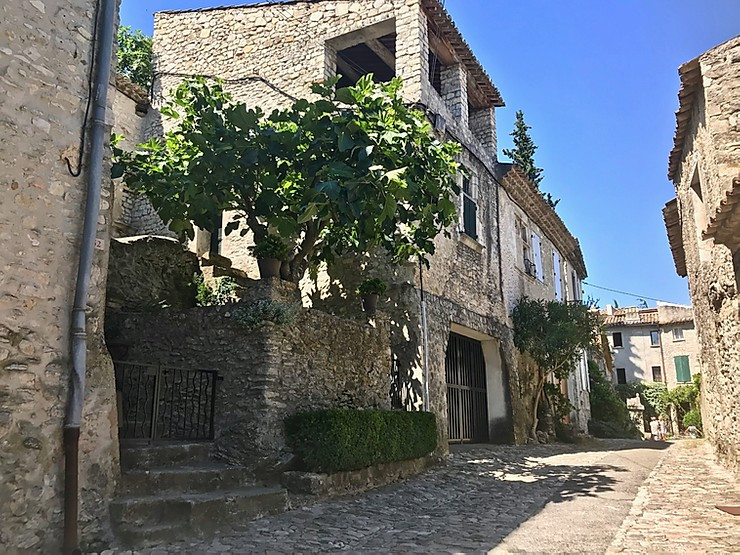 stony cobbled street and houses in Vaison-la-Romaine in Provence France