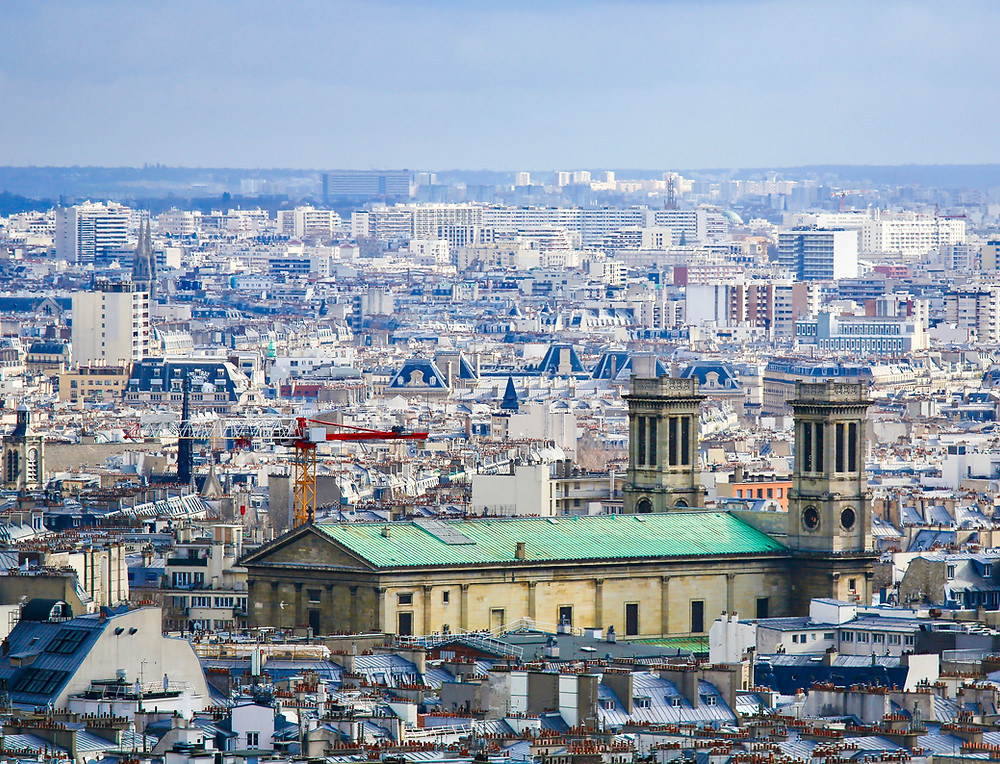 Paris cityscape as seen from Montmartre, with the Church of St Vincent de Paul, in the 10th arrondissement of Paris