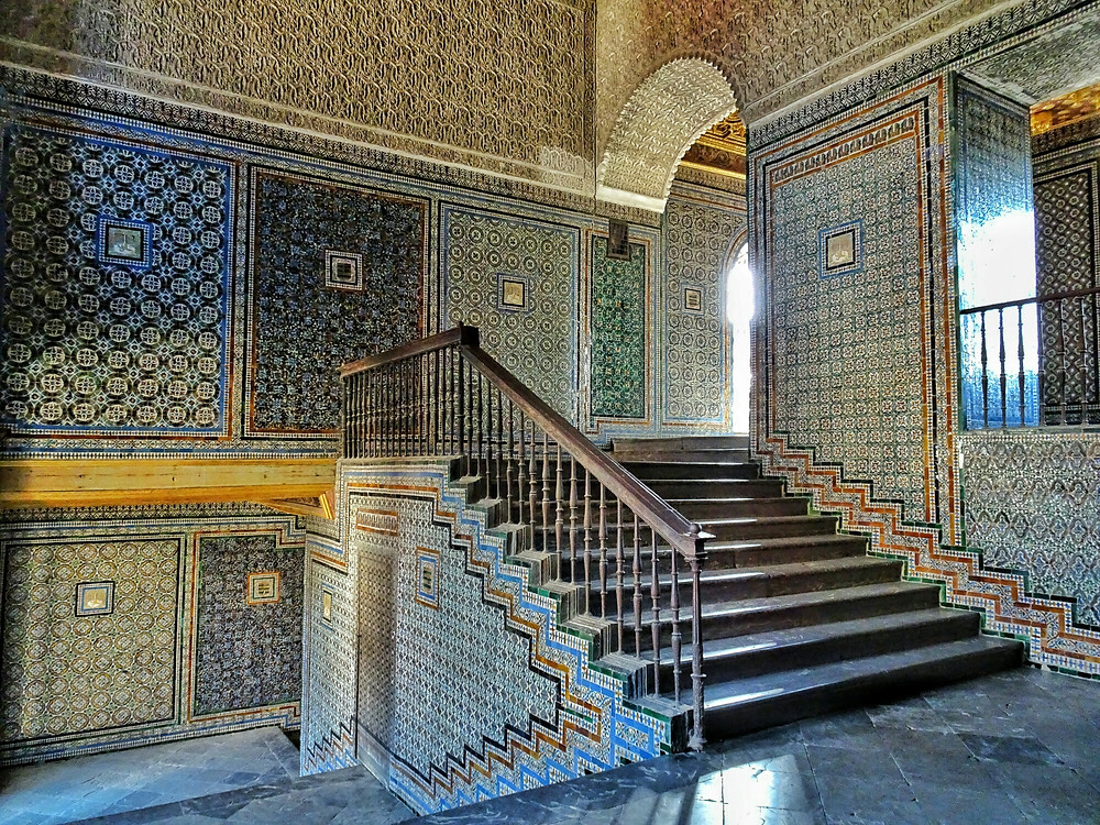 the grand staircase leading to the upper floor of Casa de Pilatos