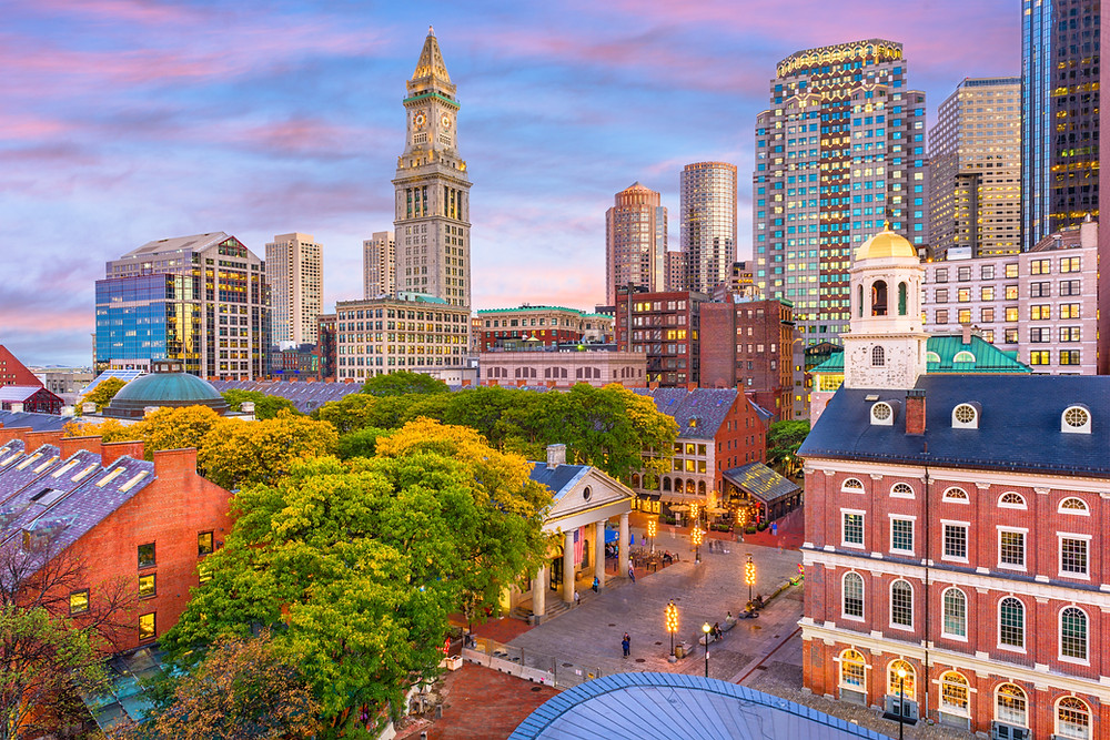 Boston skyline with Faneuil Hall and Quincy Market at dusk