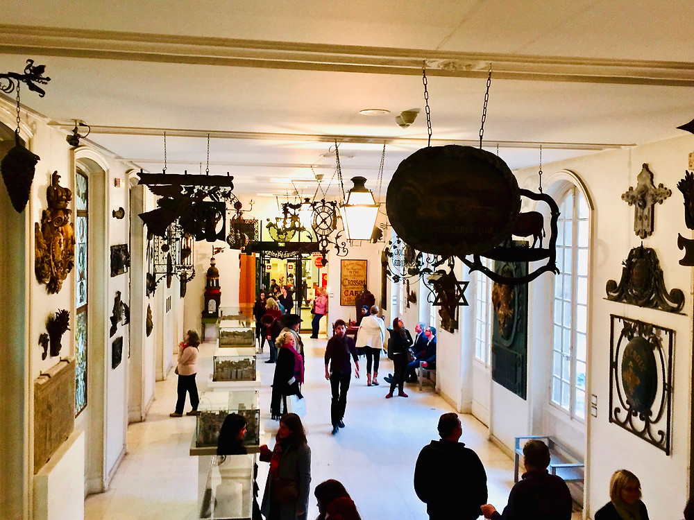 a gallery of the Musee Carnavalet filled with street signs