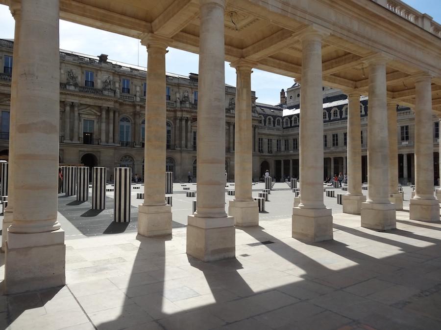 arcades bordering the gardens of the Palais Royal, and the installation of the Colonnes de Buren