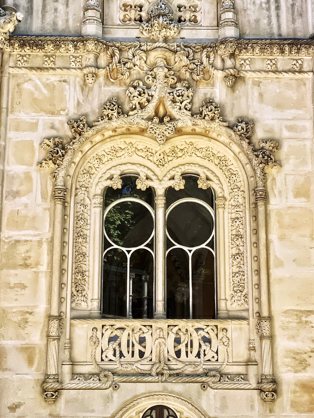 an ornately carved Neo-Manueline style window on the exterior