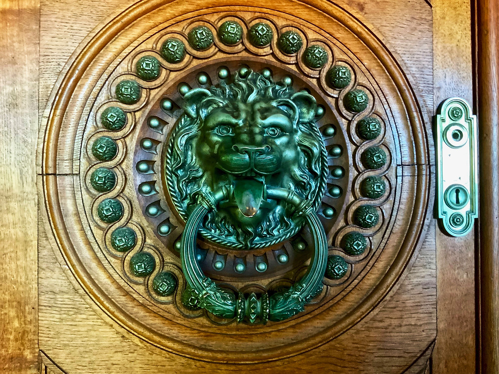an iron door door knocker in the Palace of Quinta da Regaleira