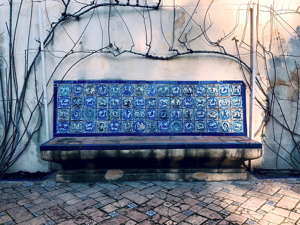 a ceramic bench in the Alcazar Gardens
