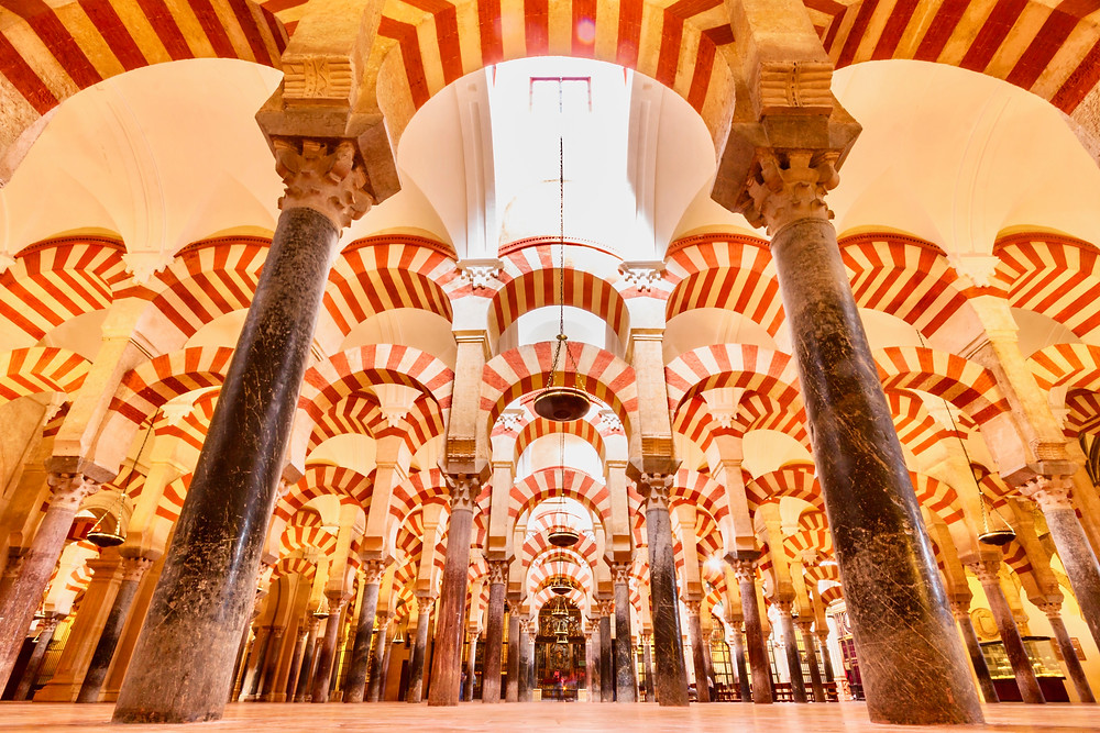 a forest of candy cane arches in the Mezquita in Cordoba
