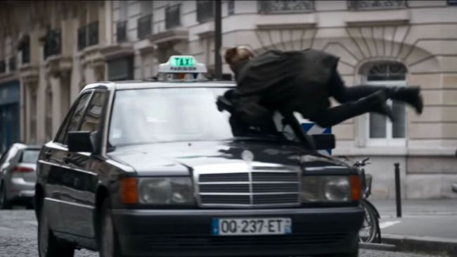 Villanelle hurls herself in front of a taxi on Rue Cesar Frank