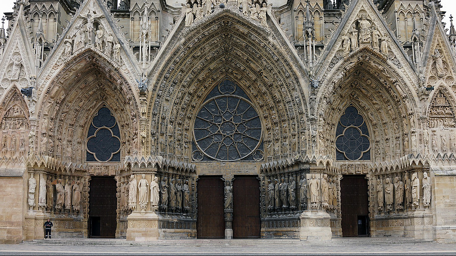 three ornate portals on the facade of Reims Cathedral