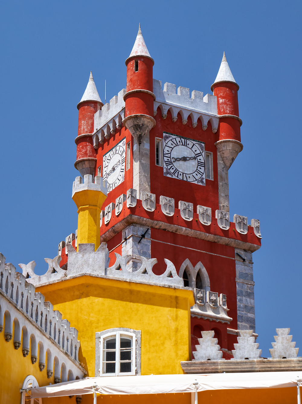 the view of the Clock tower with the turrets and battlements at  Pena Palace