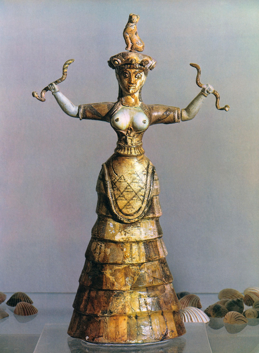 restored snake goddess sculpture, discovered at Knossos now in the Heraklion Museum