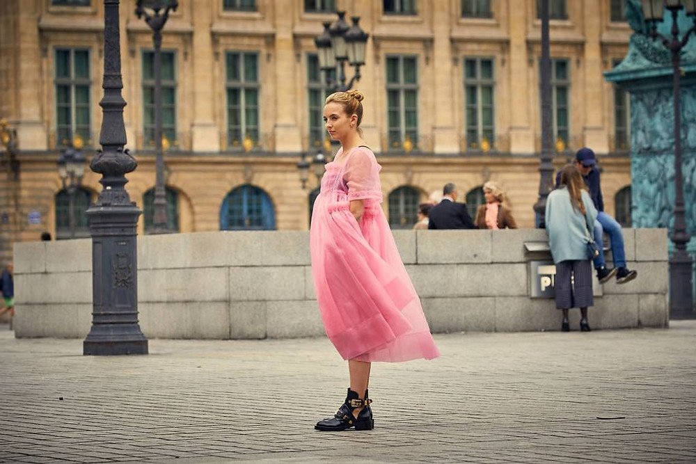 Villanelle in gauzy pink and black military boots