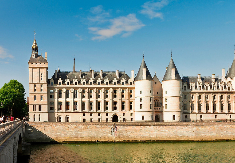 the Conciergerie, stretched along  the Seine River, is a must see hidden gem in Paris