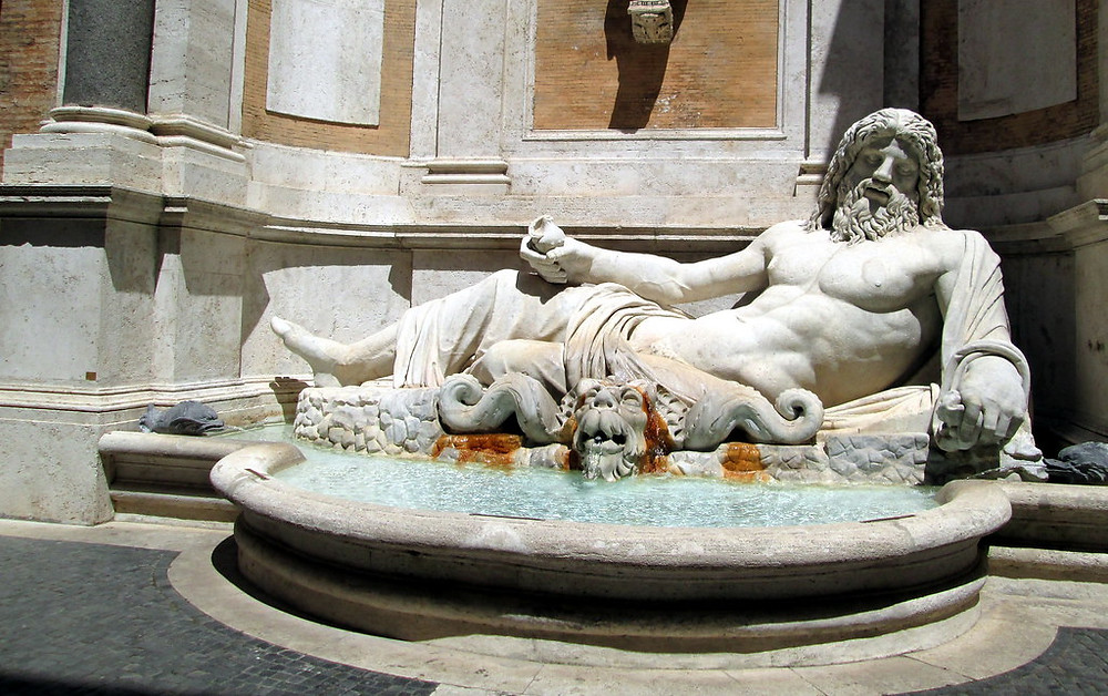 Fountain of the River God Mafario on the facade of the Palazzo Nuovo