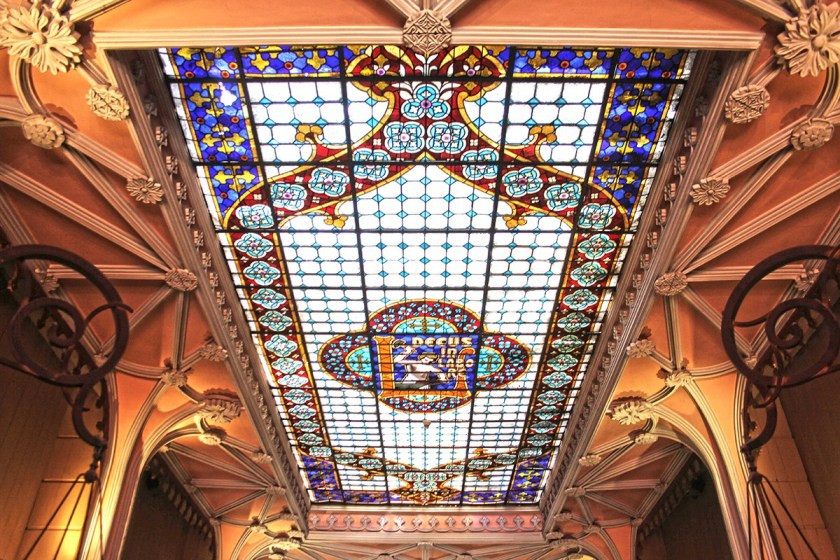 the stained glass skylight in Livraria Lello bookstore in Porto