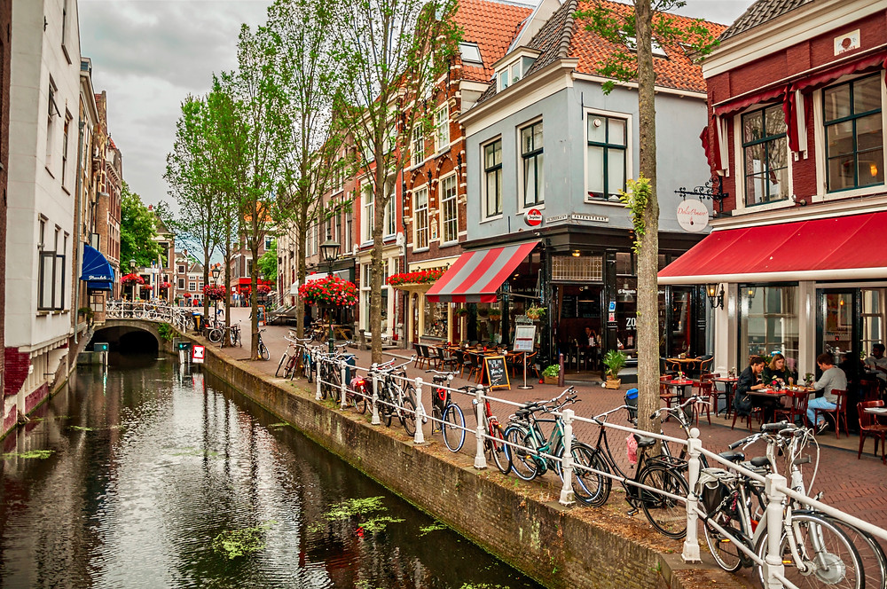a picturesque canal in Delft in the Netherlands