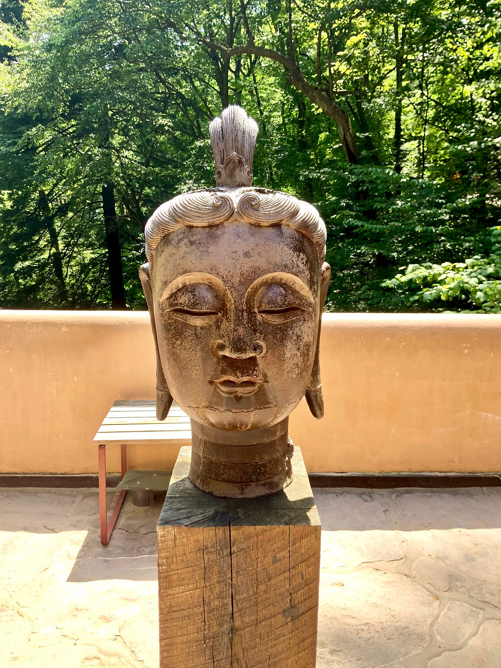 On the first floor terrace, there's a head of Buddha. It was cast in iron during the Sung Dynasty, between 906 and 1127.