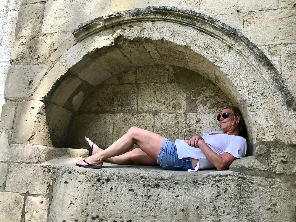 me relaxing in a niche in Les Alyscamps