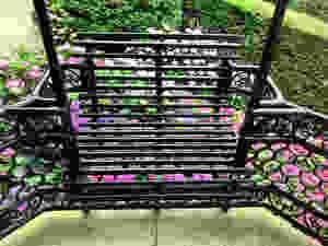 iron seats on a small balcony of El Capricho