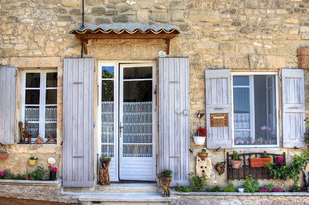 stone house with shutters in pretty Ansouis France