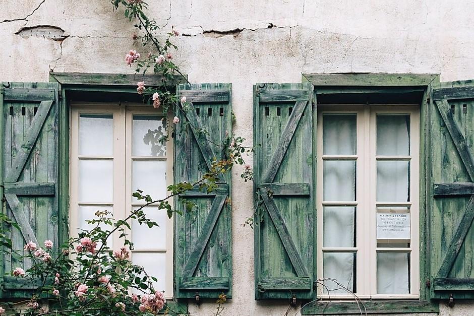romantic, rose drenched window shutter in Cordes sur Ciel