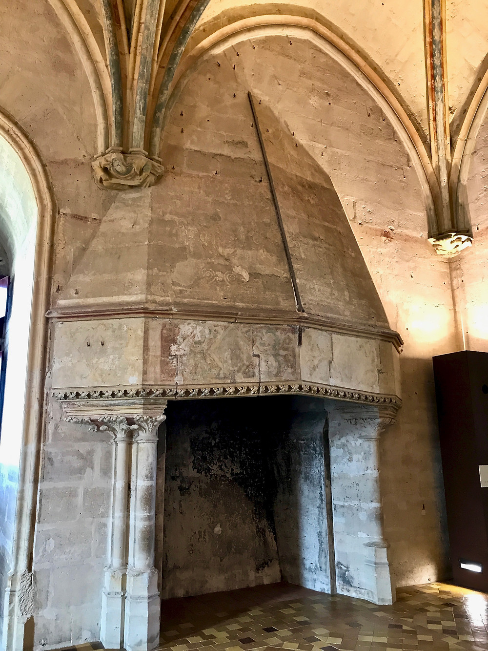 a massive medieval fireplace that you can stand in in the Chateau de Vincennes