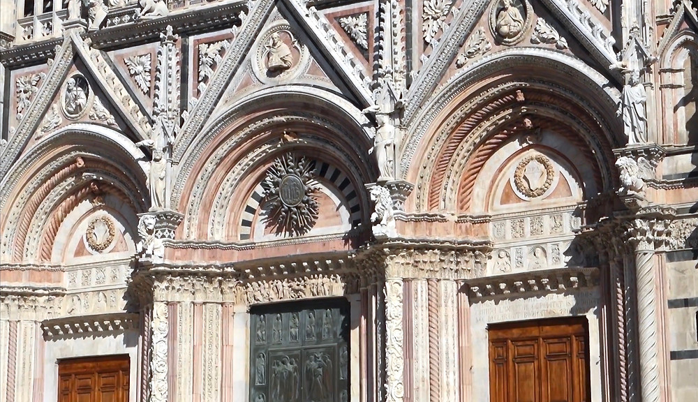the three portals on the facade of Siena cathedral